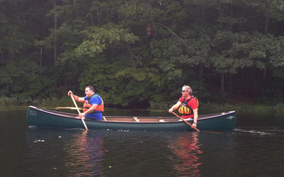Novice canoeists work in tandem to match stroke cadence