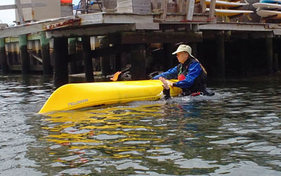 Beginning kayakers are invited to perform a wet-exit with Instructor support