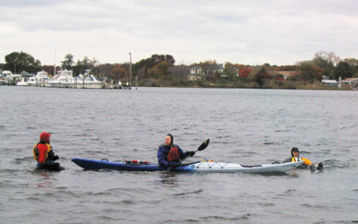 L4 Students dressed for winter paddling practice rescues